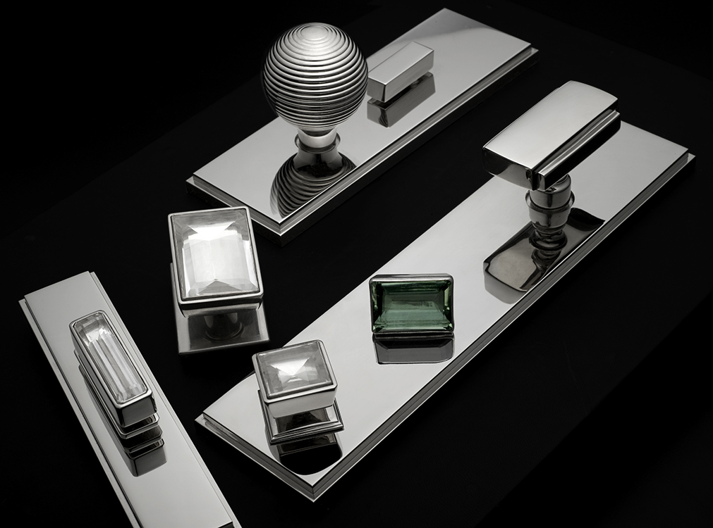Ensemble of modern hardware in polished nickel and custom rock cystal pulls.