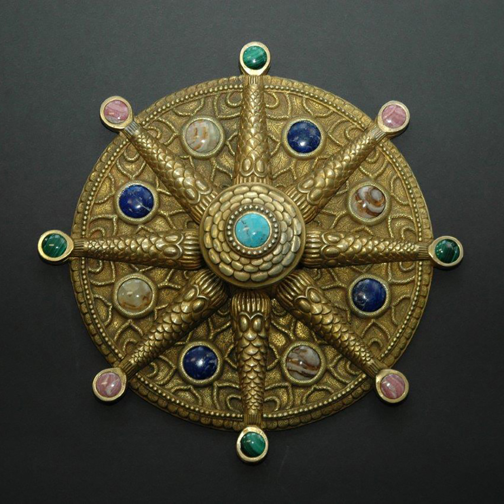 Large demi-lune plates and door pulls with studded with semi-precious stones.
